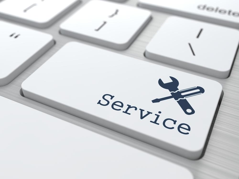 Customer Service Concept. Button on Modern Computer Keyboard..jpeg