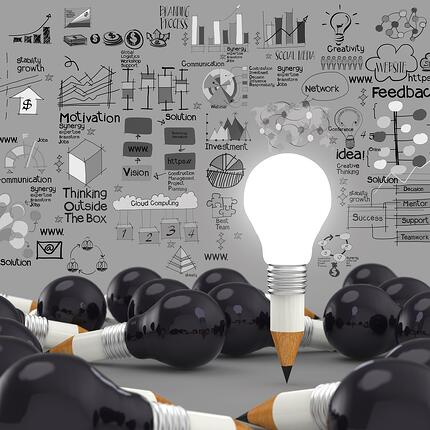 creative design business as pencil lightbulb 3d as business design concept.jpeg
