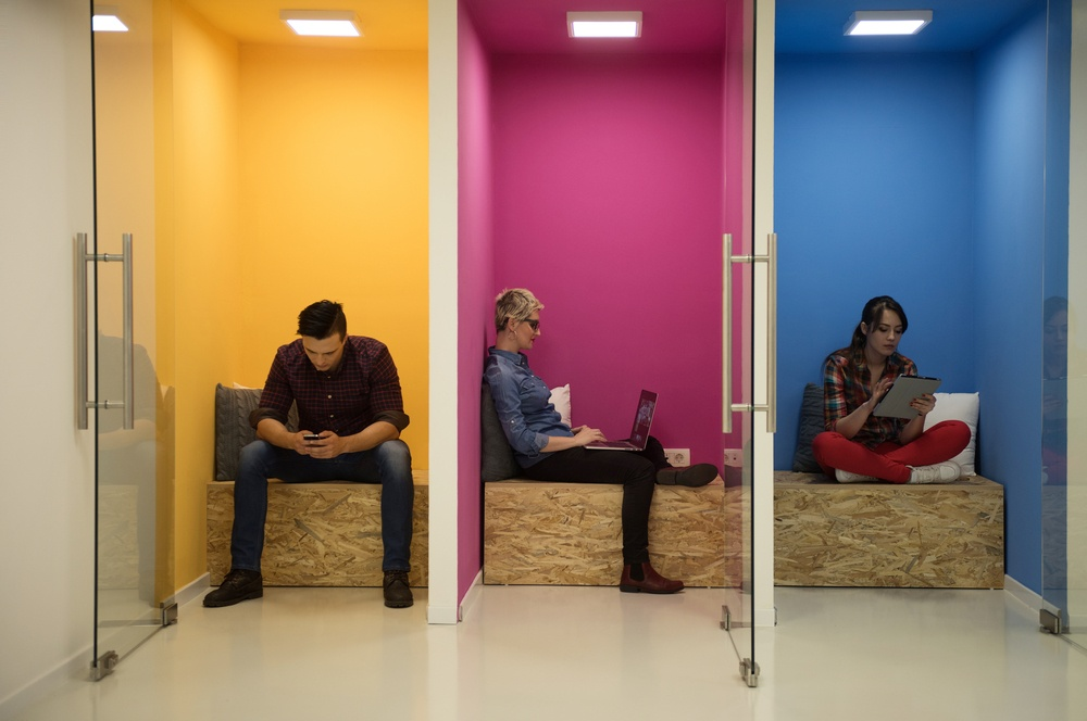 group of young business people having fun, relaxing and working in creative room space at modern startup office.jpeg