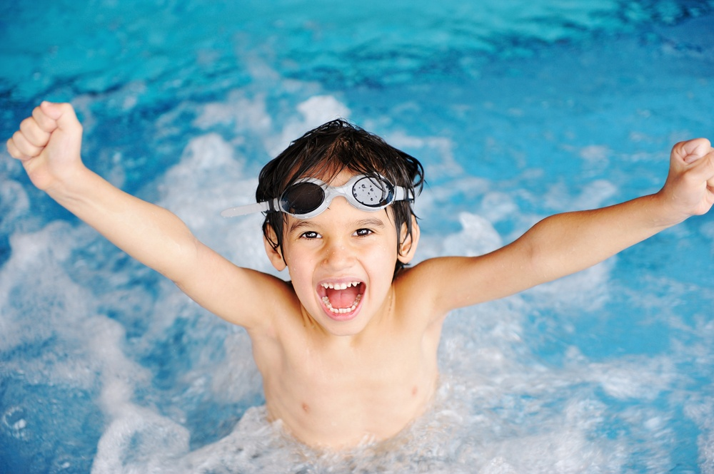 Activities on the pool, children swimming and playing in water, happiness and summertime.jpeg