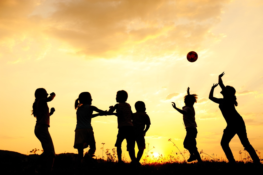 Ball playing happy children on meadow, sunset, summertime.jpeg