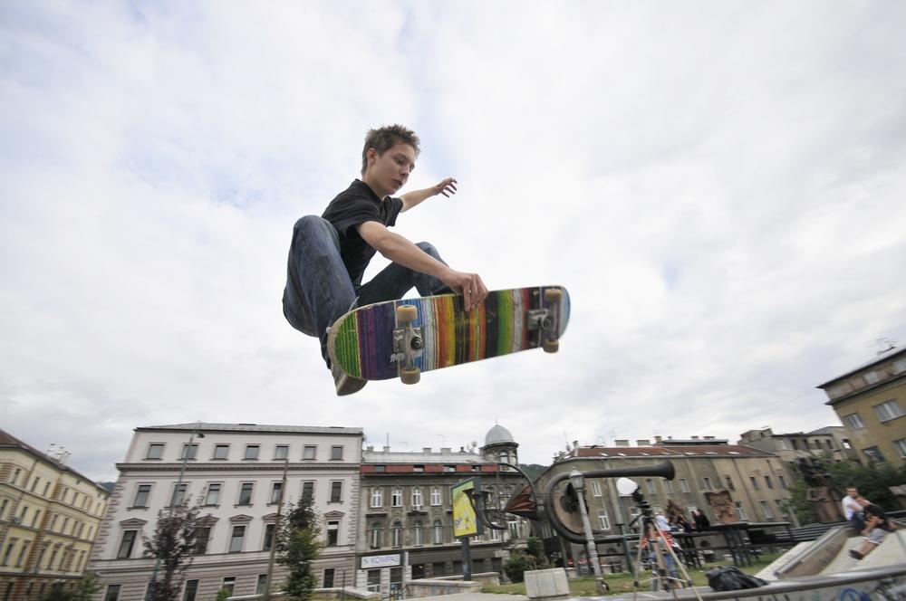Boy practicing skate in a skate park.jpeg