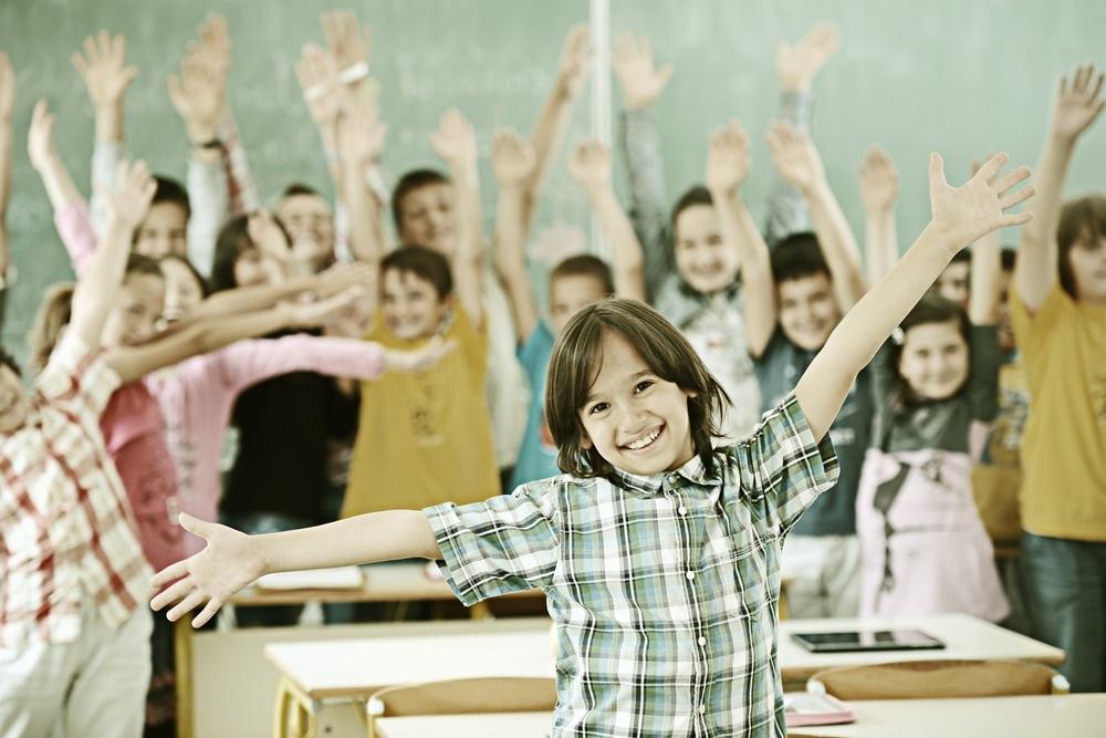 Cheerful group of kids at school room having education activity.jpeg