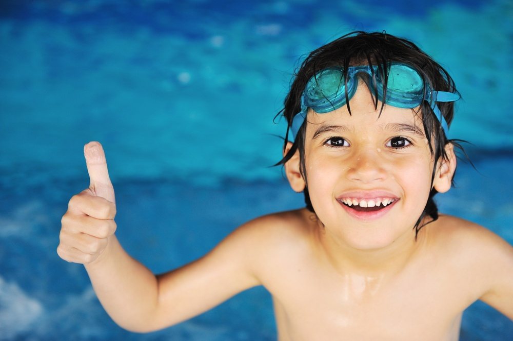 Summertime and swimming activities for happy children on the pool.jpeg