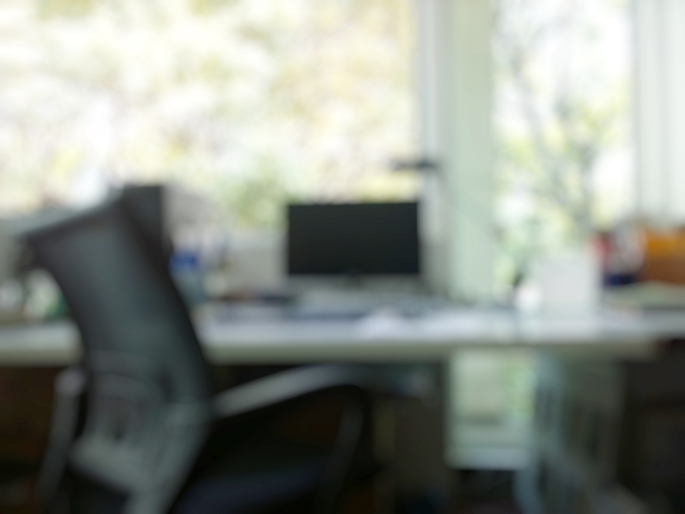 abstract office with computer blur background.jpeg
