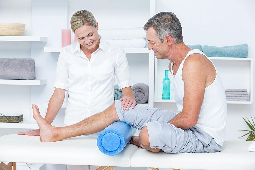 Doctor examining her patient leg in medical office.jpeg