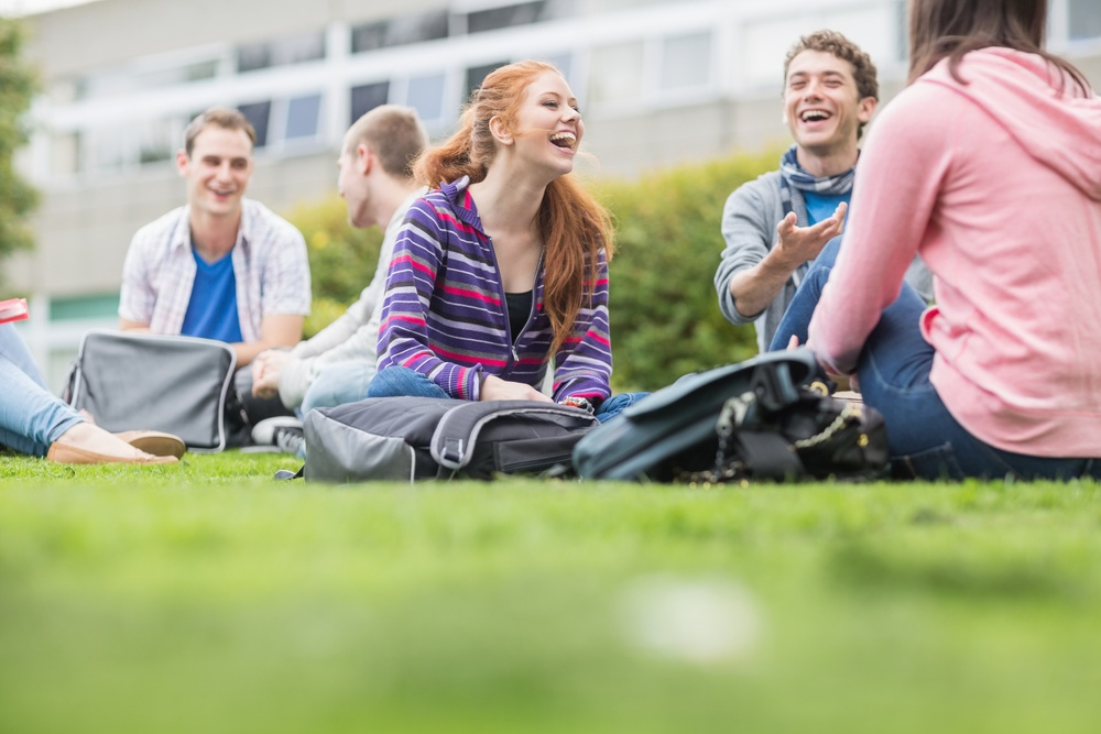 Group of young college students sitting in the park.jpeg