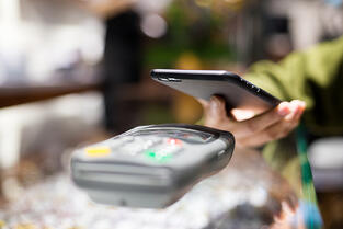 Woman paying with smartphone by NFC-2