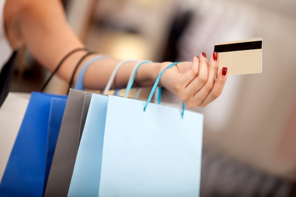 Woman shopping and paying with a debit or credit card.jpeg