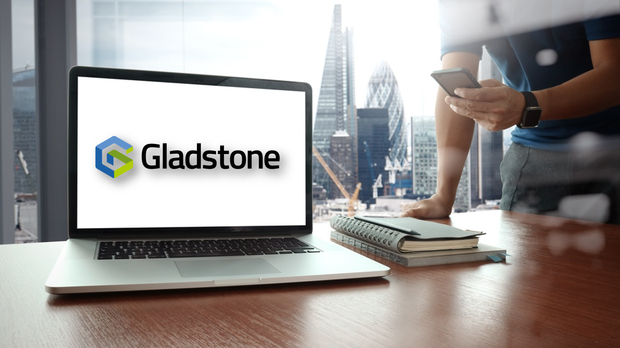 Desk with PC on it with Gladstone logo